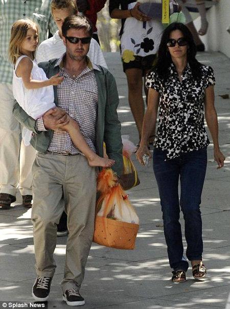 Кортни и её муж Дэвид АРКЕТТ договорились оставаться друзьями ради дочери